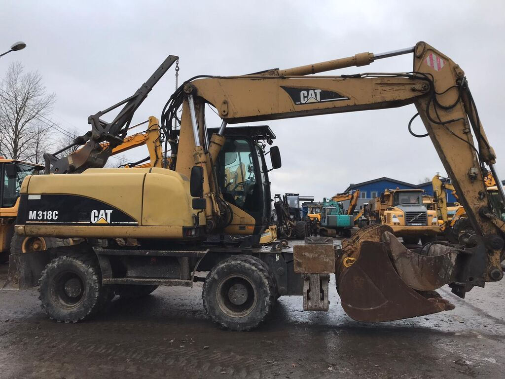 CATERPILLAR M318C riteņu ekskavators